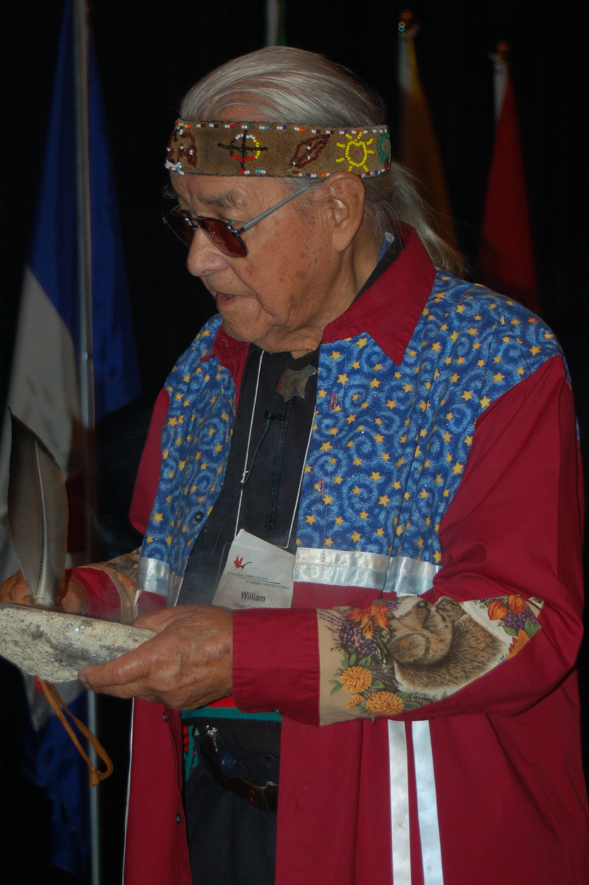 Elder William Commanda performs a smudging ceremony.
