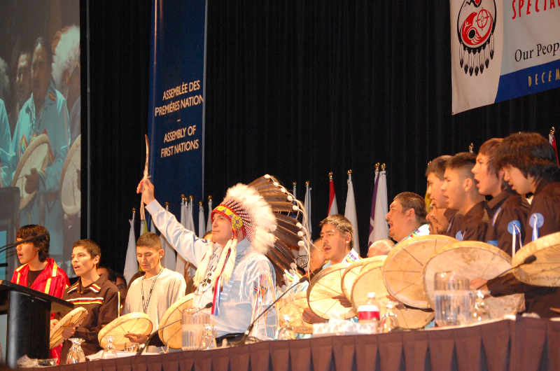 Treaty 7 Northern Dene drummers surrounded National Chief Perry Bellegarde