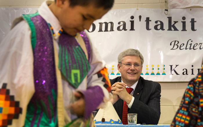PM Stephen Harper watches some young dancers at Kainai