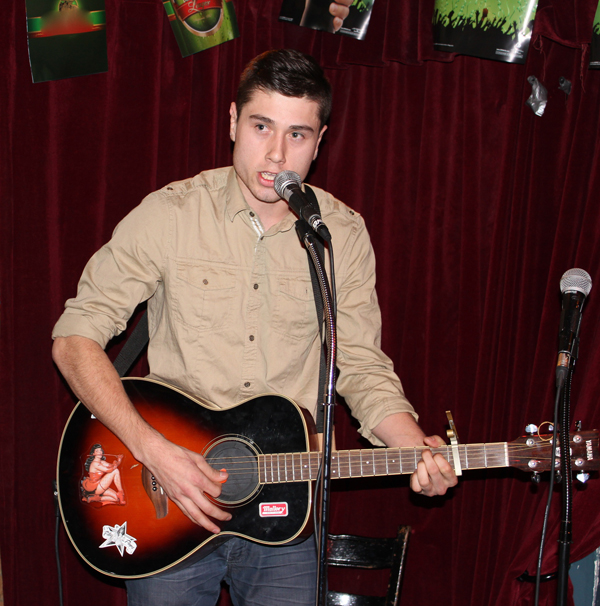 Brendt Thomas Diabo performing at an open-mic in Montreal