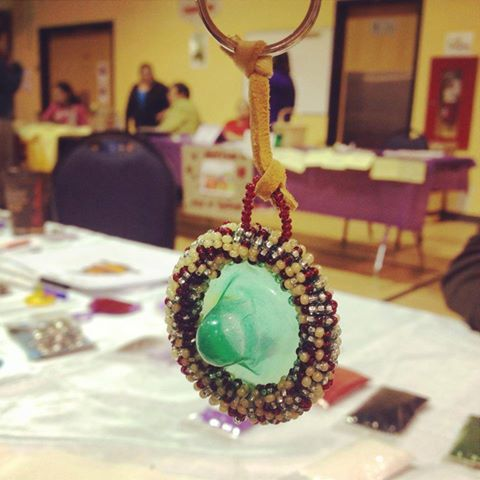 A beaded condom keychain created during a Native Youth Sexual Health Network