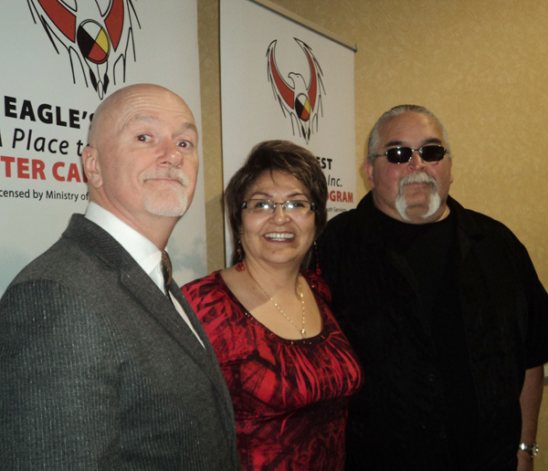 Dr. Brent Angell, Peggy Martin, and Paul Petahtegoose, enjoy a well-attended con