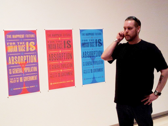 Artist Sonny Assu shown with The Happiest Future series at Ghost Dance