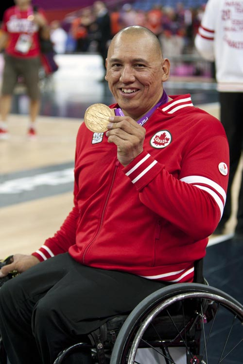 Richard Peter shows off his gold medal