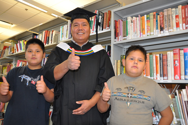 Vernon Watchmaker on graduation day with two of his seven children.