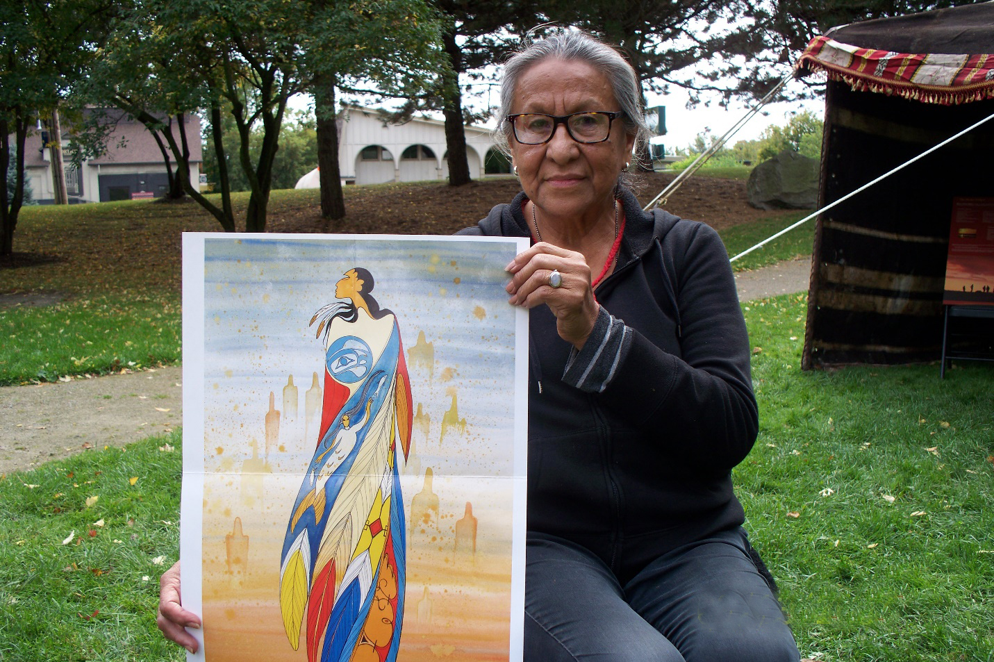 "Maxine Noel with her print entitled ""Not Forgotten"""