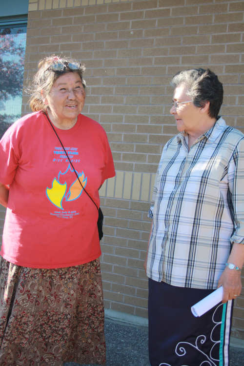 Grandmother Josephine Mandamin (left) is welcomed to Nipissing First Nation by C