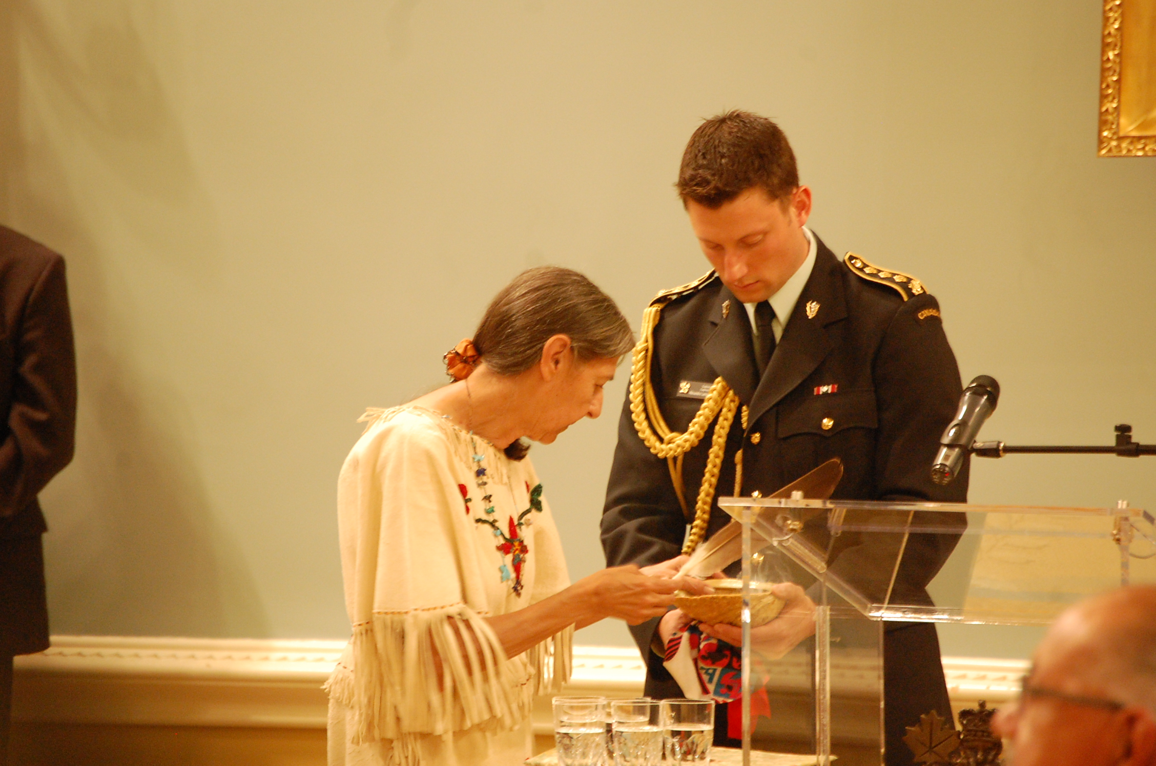Elder Evelyn Commanda-Dewache, a residential school survivor smudged and prayed