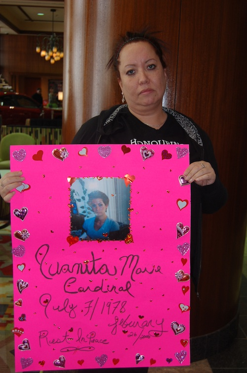 Danielle Boudreau with a poster of her sister Juanita Cardinal