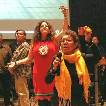Organizer Suzanne Smoke (left) and Elder Jackie Lavalley offering a prayer for t