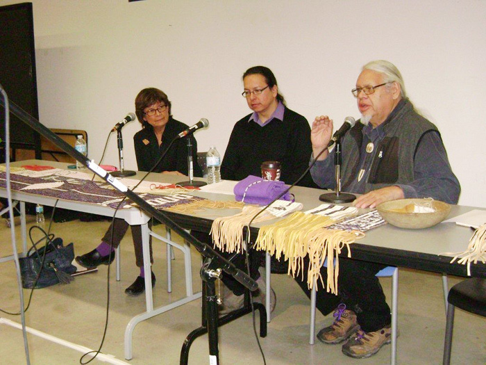 Rick Hill (right) answering questions about wampum, with Alan Corbiere (centre)
